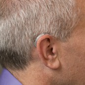 Behind-the-Ear (BTE) with a thin tube | Hearing Aid Types | Hearing Doctors of Kansas